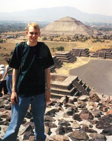Teotihuacán Mexico - Me standing on the Pyramid of the Moon, with the Pyramid of the Sun in the background