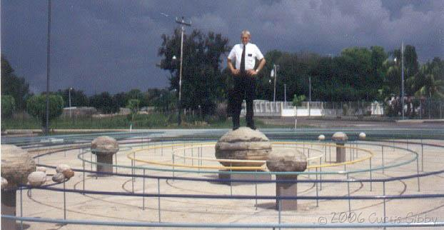 Standing on a model of the solar system in Machiques, Zulia, Venezuela