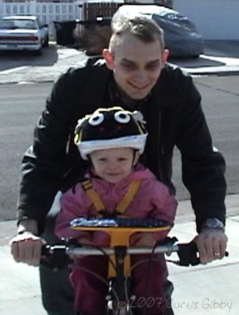 Audrey riding a bike with Curtis