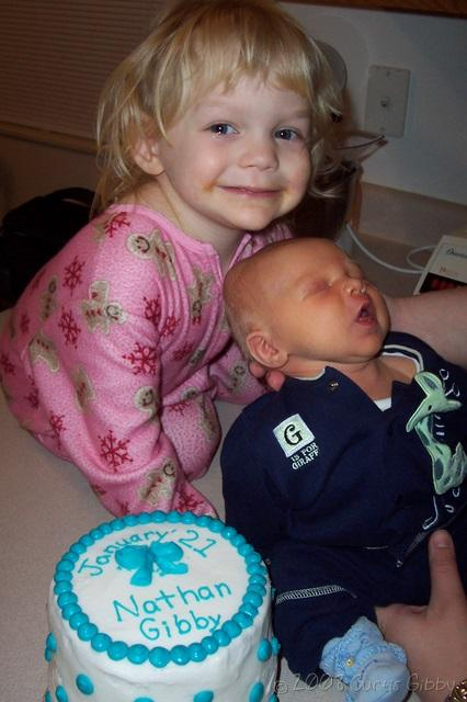 Nathan and Audrey pose with a birthday cake