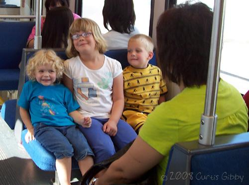 Audrey happily riding Trax with her Durkee cousins