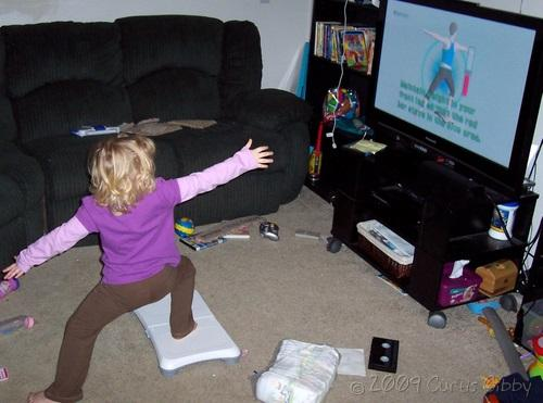 Audrey does yoga with the Wii Fit