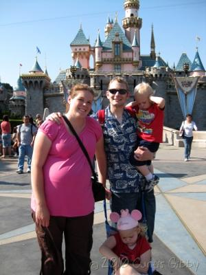 Disneyland 2010 - The Gibby Family in front of Sleeping Beauty's Castle