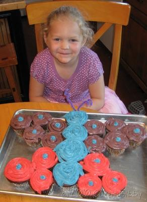 5-year old Audrey with her butterfly cupcake cake