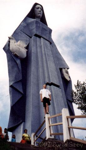 Standing in front of the Virgen de la Paz in Trujillo, Trujillo, Venezuela