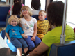View - Audrey happily riding Trax with her Durkee cousins
