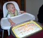 View - Nathan with his 1-year-old birthday cake