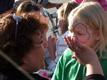 View - Audrey getting a butterfly painted on her face