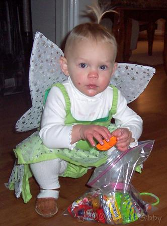 Halloween 2006 - Audrey (in her Tinkerbell costume) with her candy