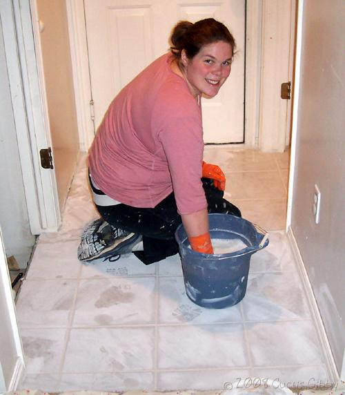 Tile project - Sarah wipes up grout downstairs