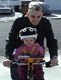 View - Audrey riding a bike with Curtis