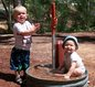 View - Audrey and Andrew play in a spigot after our hike at Red Cliffs Campground