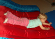 View - Trip to Wisconsin - Audrey sliding on the bouncy toy